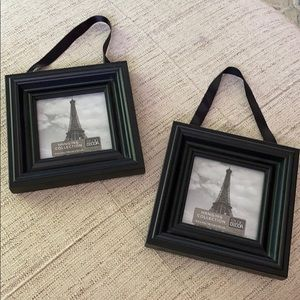 Set of small black frames with ribbon hanger.